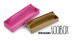 Watch this video to learn how to make an origami tray, this one is long and looks like an origami toolbox! You can use this to keep things neat on your desk,...