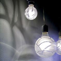 Etched patterns on these light bulbs project cool designs onto the walls
