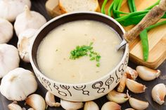 Garlic cream soup with parsley in a bowl.
