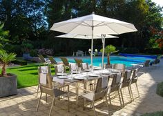 Al fresco dining by the pool at this Chateau in the Loire