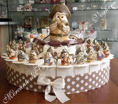 """Mercante di Sogni - Voghera - Bomboniere e Stampati dal 1969 - Vendita ai privati  Linea """"HARMONY GUFO PIRATA"""" Articoli in  resina.  Torte 18 - 24 - 42  -  Esagoni 24 - 54 Magneti - porta chiavi - salvadanaio porta foto - clip memory.  Read more: http://mercantedisognivoghera.blogspot.com/#ixzz3hDZlXOQu"""