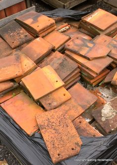 Crate of handmade orange tiles Reclaimed Building Materials, Clay Roof Tiles, Reclamation Yard, Roof Cleaning, Roof Detail, Milton Keynes, Roof Plan, Garden Features, Weird And Wonderful