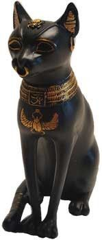 Bastet or Bast , this cat statue honoring the feline Goddess sits with wrapped tail for mantel or altar. Smooth sleek satin black with gold highlights, makes this a regal item for cat lovers and those