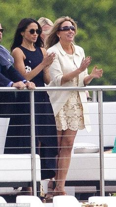 The Suits actress, 35, beamed and clapped as she watched the young royal play polo from th...