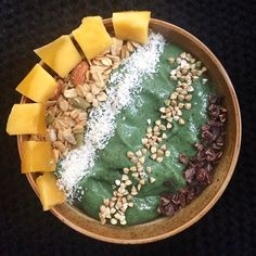 Good morning! After an hour of yoga I made my best green smoothie yet! Frozen bananas half an avo spinach spirulina and almond milk topped with raw cacao nibs buckwheat groats shredded coconut my homemade granola and fresh mango. Absolutely amazing! by superfoodmermaid