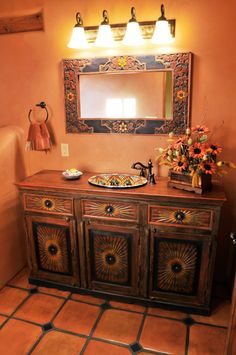 Wayne & Kiki Suggs of Classic New Mexico Homes reuse old materials. blog.picachomountain.com Decoración baño lavabo pintado.