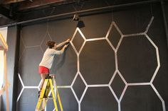 Use foil tape to create a wallpaper-like design on a wall. | 39 Easy DIY Ways To Create Art For Your Walls