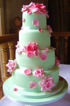 mint green wedding cake with pink roses