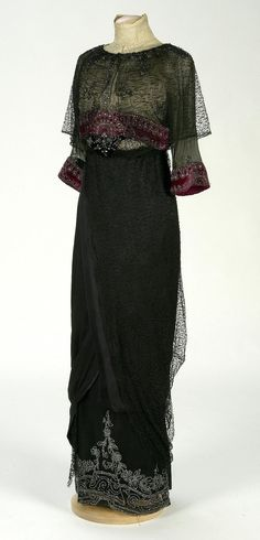 Sheer 'gothic' black and wine coloured dress from 1910-1912 - note the cross-layering on the skirt overlay and the embroidered hem.