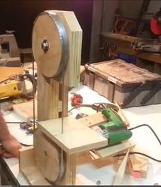 Drill-Powered Bandsaw by izzy swan -- Homemade drill powered bandsaw constructed from plywood, nuts, bolts, and an electric drill. http://www.homemadetools.net/homemade-drill-powered-bandsaw-2
