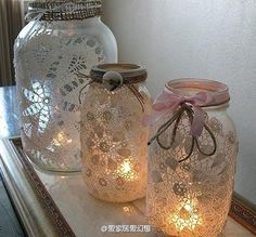 and yet another use for mason jars. The doilies make them look like snowflakes.
