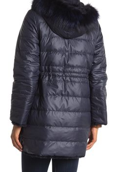 "A reversible down coat is framed with a plush rabbit fur collar. Lapel collar with rabbit fur. Long sleeves. Adjustable drawstring waist. Zip front closure. Reversible. Quilted construction. Dual slash pockets. Lined. Approx 33"" length ( size S ). Imported"