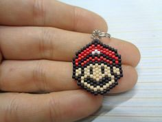 Who doenst know him Super Mario bros from the game is now made in beads Handmade charm in brickstitch by using high quality miyuki bead delicas in different colours Double ring, clasp, keyring ore necklace are nickelfree the Mario is 2 cm (13/16) high x 2 cm (13/16) In the last picture you can see the examples of the different styles, can also be made as earrings, please mail me the necklace (leather) will be 46 cm (18) With the clasp you can hang it on your bracelet or on to another neck...