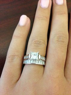 Love my wedding ring! Princess cut diamonds are the best!