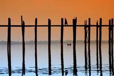 U Bein's bridge (Myanmar) is a teak structure almost 1,200 meters across the Taungthaman Lake, near the ancient Burmese capital of Amarapura. It is said to be the longest and oldest teakwood bridge in the world. The bridge was built in the mid 1800's by by salvaging unwanted teak columns from the old palace when the reigning King Mindon decided to move the capital to Mandalay. U Bein's bridge is supported by more than 1,000 pillars and thousands of wooden planks. - this is truely…