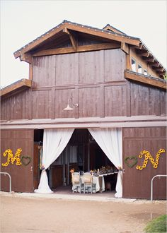 Barn with bride and groom wedding initials- vintage marquee instead of flowers? I could mount them in the house when I'm done