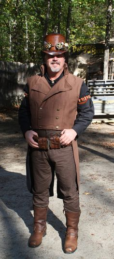Mens Cut Away Frock Coat with Tails    This is a double breast cut away frock coat with tails. The material is a heavy canvas which lends
