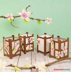 Japanese paper lanterns covered with paper flowers
