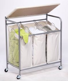 This dual purpose Honey-Can-Do Sort and Iron Triple Laundry Center features a built-in ironing board that lifts ups easily to expose a full-featured triple sorter below. The thick foam pad and heat-resistant, 100% cotton cover provide a smooth ironing surface every time. The sorter boasts three removable polyester bags, which make for simple sorting and convenient carrying and washing. The laundry bags incorporate mesh sides for ventilation and an interior coating to resist mildew and odors…