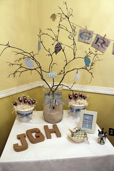 Cute idea for a baby shower - everyone writes a wish for the baby and hangs it on the tree.