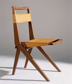 Lina Bo Bardi, foldable chair in wood and leather (1948). Photograph by Nelson Kon.