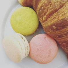 The breakfast of champions - french butter croissants and colorful macarons