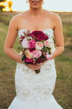berry toned bouquet, photo by Love Katie + Sarah http://ruffledblog.com/fruit-packing-shed-wedding #weddingbouquet #flowers