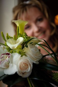 A bridal bouquet fit for a queen. Roses, cala lilies and orchids, wedding flowers, bridal flowers.