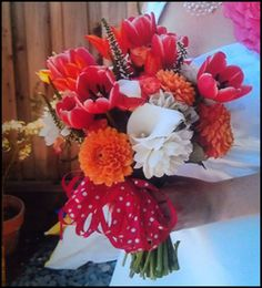 bright brides bouquet with tulips, dahlia, roses, veronica and polka dots
