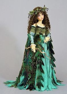 doll with a pretty green dress