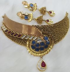 Nakoda Jewels is Dealers and Manufacturers of Artistic Gold Jewellery, Antique Gold Jewellery, Calcutta Jewellery and Specialized in Customized Jewellery in Mumbai. Gold Jewellery, Wedding Jewelry, Indian Accessories, Gold Choker, Bridal Sets, Necklace Set, Antique Jewelry, Chokers, Jewelry Design