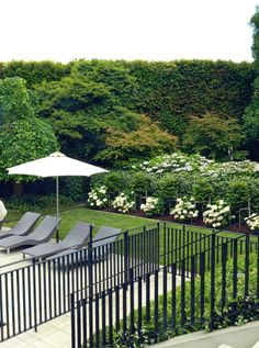 A custom-built wrought-iron pool fence fits the style of the site.