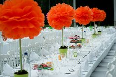 Tissue Paper Pom Poms Topiary Centerpieces. Great inexpensive alternative to flowers.