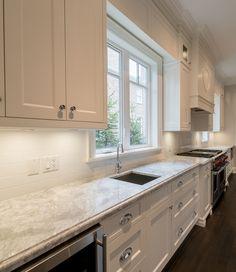 White Kitchen Ideas. Super White Granite, CC40 Cabinetry, Decorative Hood,  Wolf Range