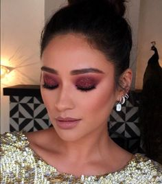 We all know red is a staple shade for lips, but as of late, the hue has made its way onto the lids and cheeks of countless celebs — and we are digging the endless variations. The only downside: As with the gray-lipstick trend happening right now, pulling off a scarlet shadow can be tricky —