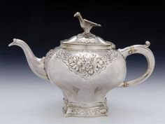 Silver teapot with four bulging sides meeting at sharply defined corners, by Lothian and Robertson, Edinburgh, 1753 - 1754, engraved with swags of naturalistic flowers, leaves and berries