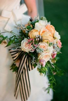 Bride's Lovely Bouquet Showcasing Several Varieties Of Peach Roses, Pink Ranunculus, Silver Brunia, White Florals, Several Varieties Of Greenery & Foliage Hand Tied With A Striped Satin Ribbon ~~