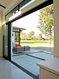 "The couple used Fleetwood doors to execute their vision of a home that blurred the line between indoors and outdoors, with the exterior walls ""disappearing."" While the doors were one of the biggest expenses for the couple, they consider them well worth it Interior Barn Doors, Exterior Doors, Fleetwood Doors, Fleetwood Windows, Door Design, House Design, Window Design, Slider Door, Modern Entry"
