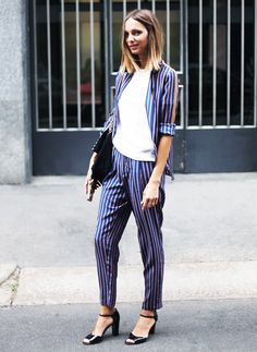 Matching striped suit, white top, and black peep-toe ankle strap heels