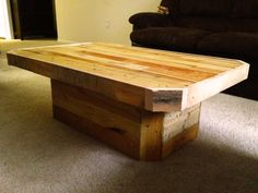 Clean island style wood pallet coffee table with a small closed off base