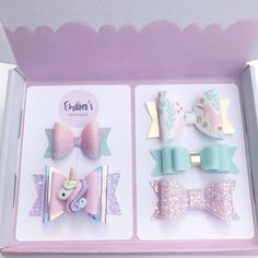 Pastel Unicorn Theme Set of Bows ideal to give as a gift, presented in a box as shown, please note the colour of the tissue paper may vary. The Set contains 5 Bows which vary in size from 2.5 inches wide to 3 1/4 inches wide and can be put on elastic for babies or an Alligator Clip.