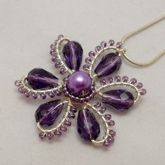 This pendant is made with silver plated wire, purple glass teardrop beads, and Czech seed beads. This flower pendant is one of my signature pieces because I love flowers. The diameter of the pendant: 1,77  (4,5 cm)  The silver plated necklace is 16 ( 41 cm ) long.    I will send it in a gift box.    Upgrade shipping: https://www.etsy.com/listing/155867190/fedex-1-3-business-days-international?ref=shop_home_feat and receive your item in 1 week
