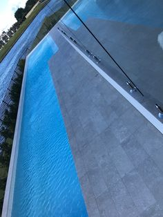 Concrete Look porcelain tiles with anti slip surface for this luxury water front poolside and outdoor entertainment area Outdoor Tiles, Outdoor Flooring, Outdoor Pool, Outdoor Decor, Modern Pools, Entertainment Area, Porcelain Tiles, Outdoor Entertaining, Outdoor Projects