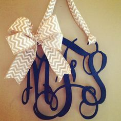 3 letter wooden monogram door hanger with bow on Etsy, $65.00