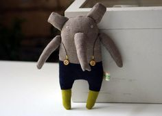 Elephant is made from 100 % natural linen.  Inside - polyester stuffing.    * Hand embroidered body  Elephant is about 21cm x 9cm /8,2 x 3,6 inch.
