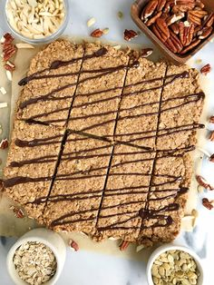 Delicious Vegan Breakfast Granola Bars made with gluten-free and dairy-free ingredients. Filled with oats, pecans, almonds and more for an easy breakfast. Healthy Granola Bars, Homemade Granola Bars, Healthy Snacks, Healthy Deserts, Paleo Treats, Healthy Sweets, Yummy Treats, Gluten Free Breakfasts, Clean Recipes
