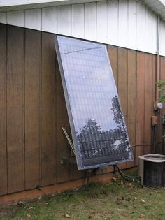 Pop can solar air heater mounted on wall, created by my amazing husband, Guy Sperry.