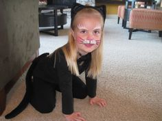 cat costume with face paint (Steph Miller original)