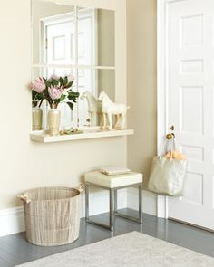 "Cute idea! From Martha Stewart: ""If you want to brighten your entryway, create a ""window"" using basic bevel-edged mirrors. To start, prime and paint a floating shelf the same color as your walls to give it a seamless built-in effect; then install it three feet off the floor (standard height for a console). Add a grid of mirrors above, leaving about an inch around each to mimic windowpanes. For a flush, bracket-free look, attach the mirrors to the wall with construction adhesive made for mirr..."