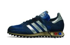 Trainer, Year Introduced: One of the few adidas releases to feature adjustable peg cushioning, the L. Trainer was released to coincide with the 1984 Olympic Games in Los Angeles. With its traditional design and the unique pegs. Casual Sneakers, Sneakers Fashion, Adidas Originals Jeans, Adidas Men, Adidas Sneakers, Sergio Tacchini, Sports Footwear, Vintage Sneakers, Vintage Adidas